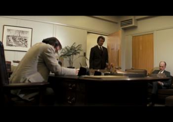 Minute 69 – Pallid Office Scene